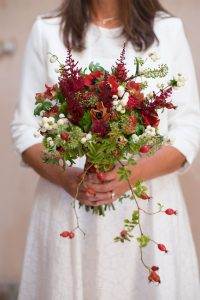 Red winter bridal bouquet Berkhamsted bride